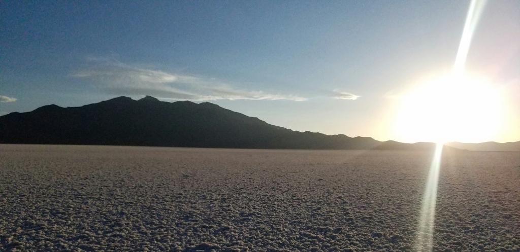 Sunset on Salt Flats behind a Mountain